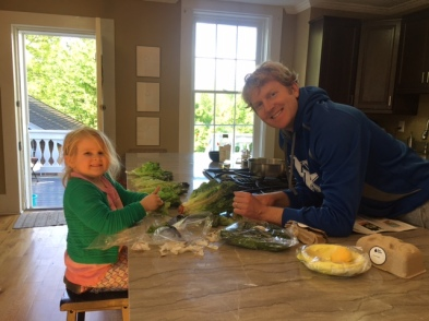 Elinor helping to cook a healthy dinner.