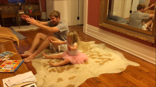 Elinor doing sit-ups with Daddy.
